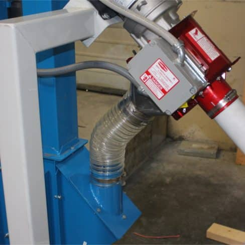 Flex auger going into a bucket elevator