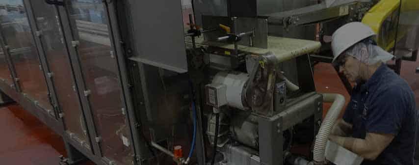 man servicing equipment